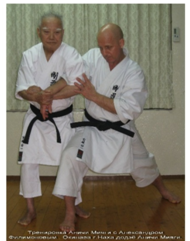 In the photo: An'ichi Miyagi is making submission lock with Alexander Filimonov